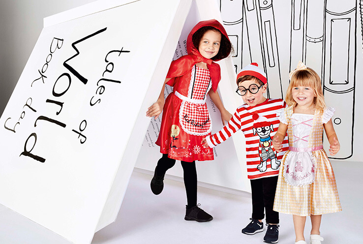 World Book Day 2020 - Girl in a Little Red Riding Hood costume, boy in a Where's Wally costume and girl in a Goldilocks costume