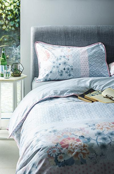 Transform your bedroom into an indulgent oasis with blue bedsheets and soft cushions at George.com
