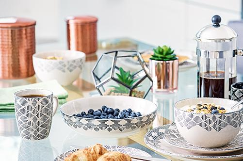 Create the perfect table spread with monochrome dinnerware and copper accessories at George.com