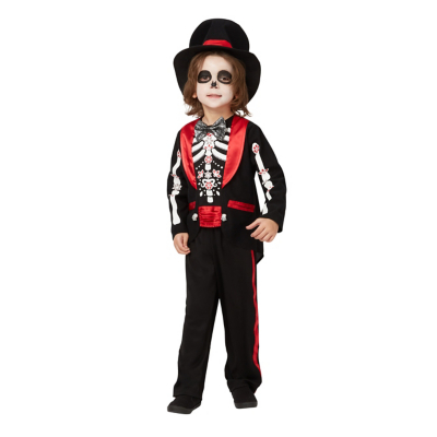 Young boy dressed in a day of the dead suit with top hat