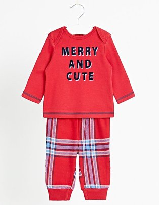 Red 'MERRY AND CUTE' slogan pyjamas on a white hanger.