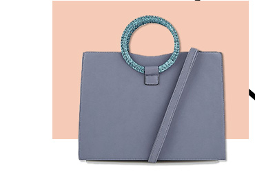 Stylish and spacious, this grey box bag is a standout option for carrying the essentials and more