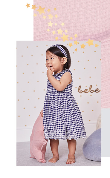 Dress your little one in this blue gingham dress