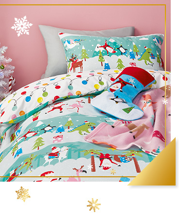 This bedding for kids features a playful Santa in the North Pole