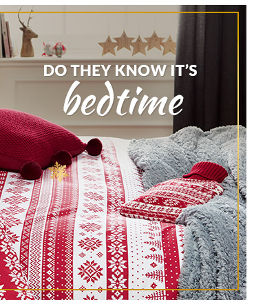 For a subtler look, try this red Christmas pattern bedding