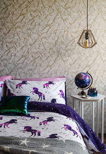 Give the bedroom a space age touch with cosmic-themed bedding and accessories