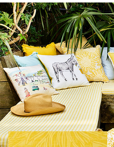 Scatter wildlife and seaside-inspired cushions around the home