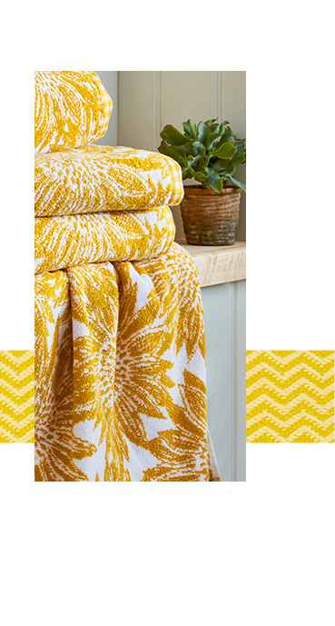 Brighten up the bathroom with yellow floral towels