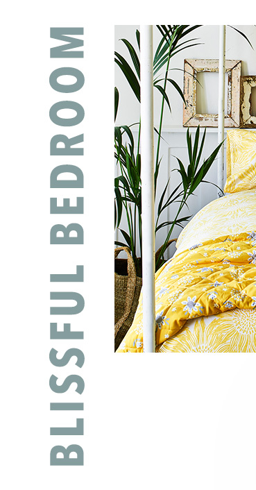 Add sunshine to the bedroom with yellow floral bedsheets