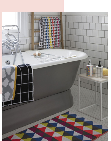 Fill the bathroom with bright towels and fun soap dispensers