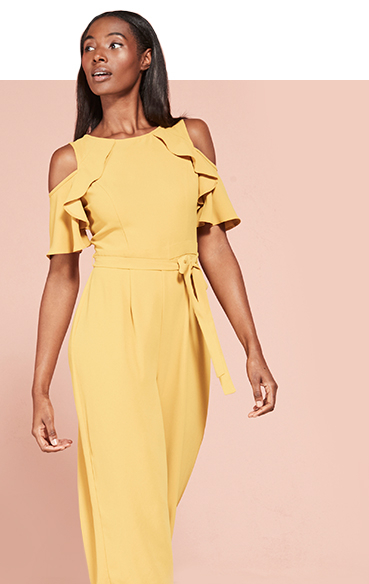Make an entrance in a yellow jumpsuit