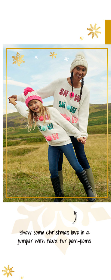 This SNOW slogan Christmas jumper comes in sizes for adults and kids