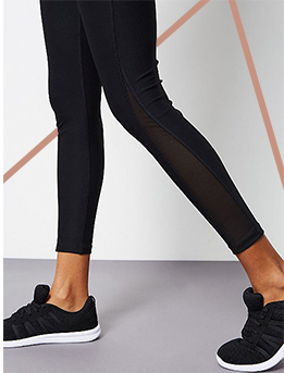 Stay comfy in black leggings and matching sports trainers