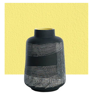 Just add flowers to this ceramic vase, complete with etched white lines