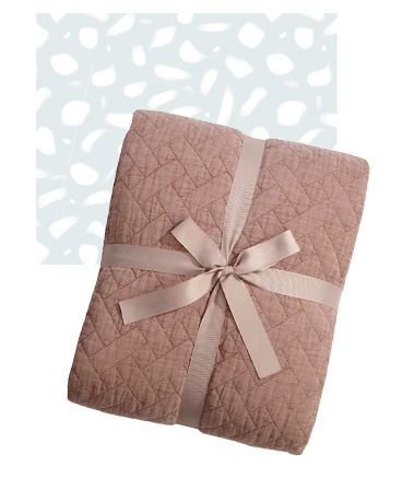 Snuggle down with a quilted throw