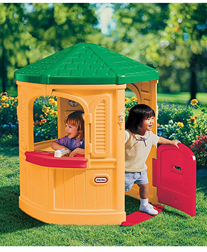 This cozy children's Little Tikes playhouse features home-like details such as large windows, a working Dutch door and more
