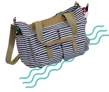 This changing bag has lots of practical pockets for storage space and includes a folded changing mat inside for use whilst on the go