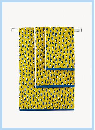 Set of three yellow leopard print bathroom towels