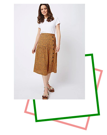 Made with a buttoned side design, this midi skirt is a stunning piece you'll love to wear