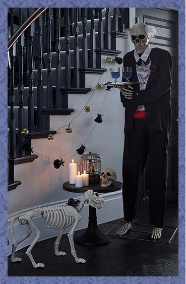 Skeleton butler serving drinks with pet dog skeleton