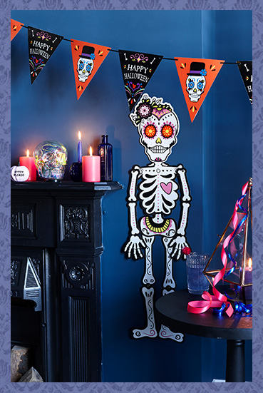 A room featuring a skeleton wall decoration and Halloween banner