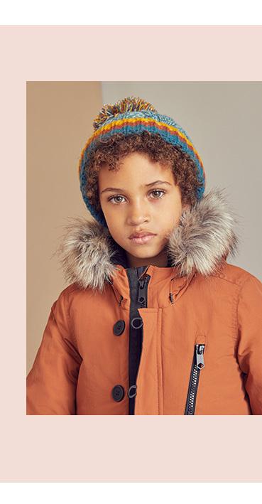 Keep them snug and stylish in an orange parka coat
