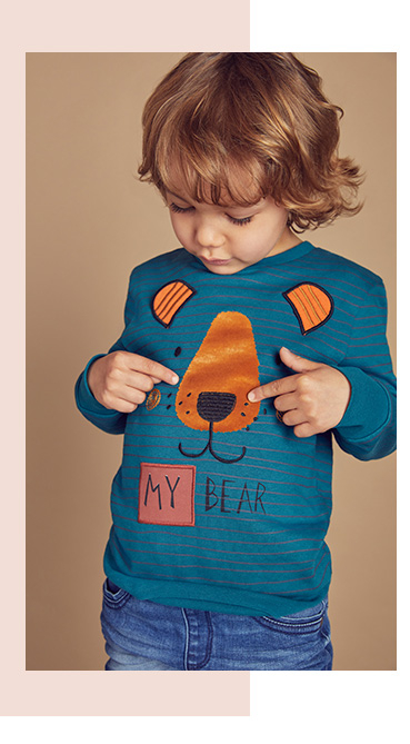 This fun bear print long sleeve top will add a touch of character to any outfit