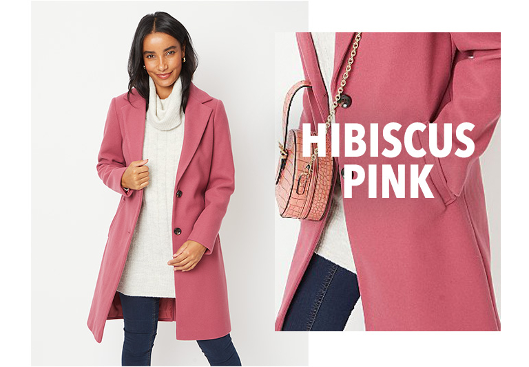 Model wearing pink longline formal coat with a cream roll neck jumper and jeans