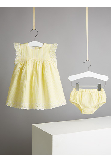 Dress your little sunshine in this yellow gingham dress and bloomers outfit