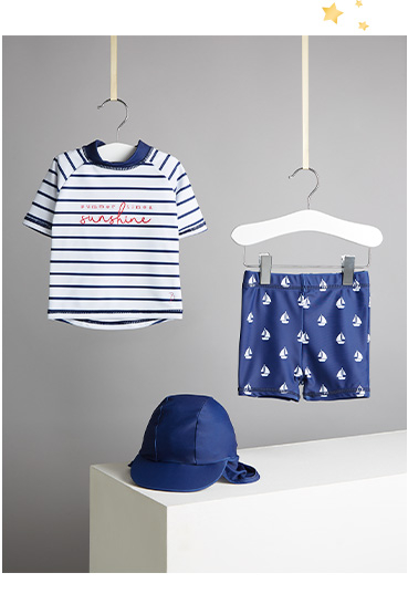 Get them set for the pool with this striped sailor-style swimsuit and hat set