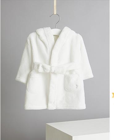 Product shot of white fleece dressing gown on hanger