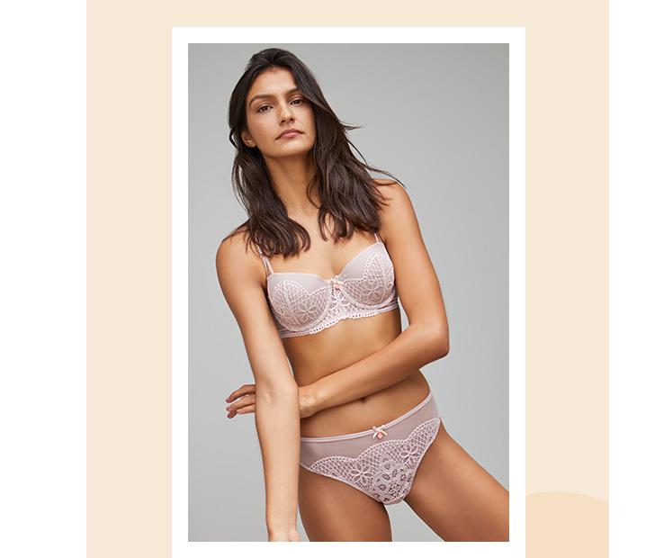 Woman wearing a pink lace lingerie set