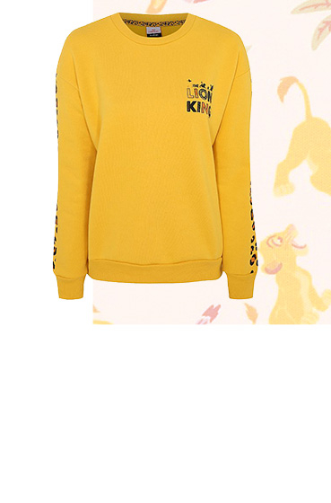 Add a dash of Disney couture to your casual wardrobe in this cosy yellow sweatshirt