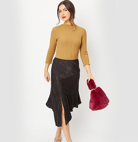 Gif of woman wearing 3 different outfits: tan coloured top and a black satin midi skirt, pink blouse and a black velour iridescent sequin feather skirt and a patterned blouse with a leopard print mini skirt