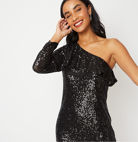 Gif of woman wearing 3 evening outfits: red sequin midaxi dress, black glitter one shoulder jumpsuit and a black sequin one shoulder frill dress