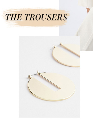 Polish off your look with a pair of gold-tone disk earrings
