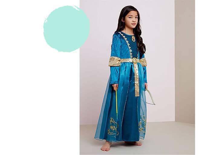 A girl wearing a Disney Merida fancy dress costume
