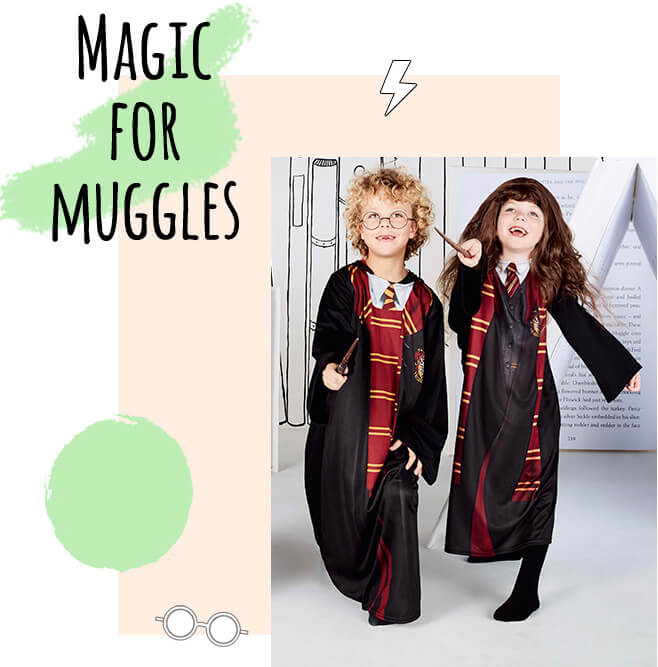 A boy and girl wearing a Harry Potter fancy dress costume