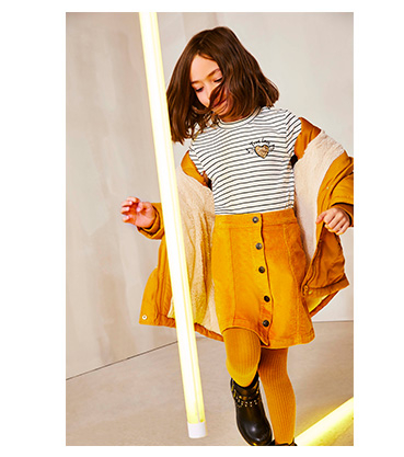 They'll shine like the sun in a matching ochre skirt, tights and coat