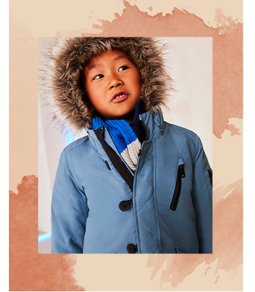 Keep them warm and cosy in a blue coat with faux fur trim hood