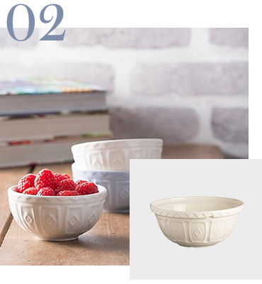 Image of two bowls stacked on top of each other and one bowl filled with raspberries