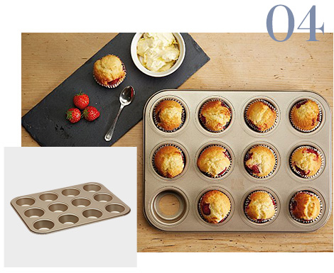 Birds eye view of muffins in muffin tin, muffin tray and muffin and strawberries on a black board