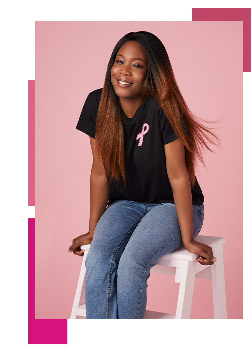 Woman wearing black T-shirt with Tickled Pink logo in the corner
