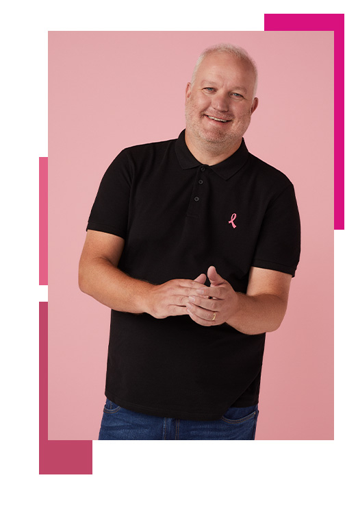 Man wearing a black polo shirt with the Tickled Pink logo in the corner