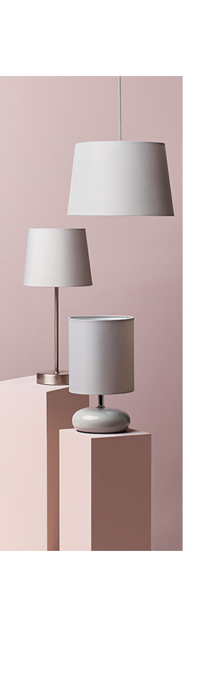 Two grey lamps on pink plinths and a grey light shade hanging from above