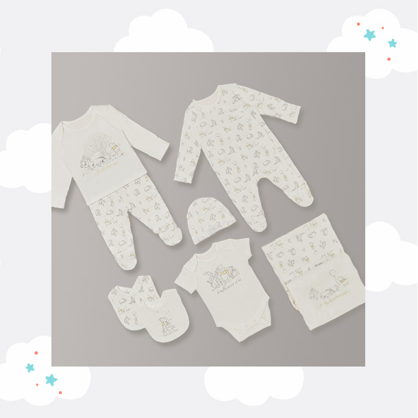 Matching Disney clothing, including an all in one, top and bottoms set, bibs and more