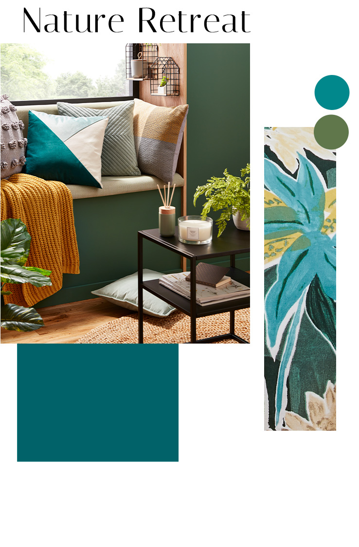 Sofa with an assortment of cushions and a gold throw, and a side table with a candle, reed diffuser and artificial plant