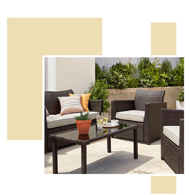 An outdoor area with a Jakarta garden furniture set with patterned cushions and accessories