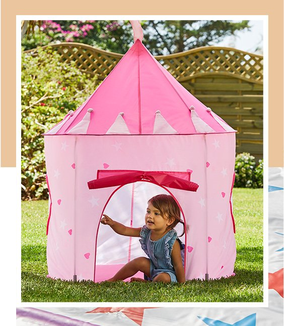 Pink pop up castle tent with child playing inside