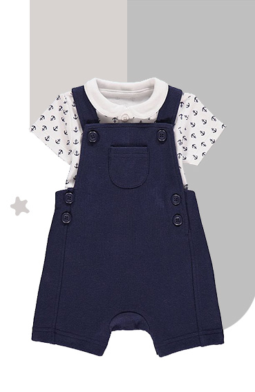 This outfit includes navy dungarees and a white polo shirt with nautical symbols